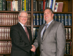 Attorneys Douglas A. Tull and Andre Laubach