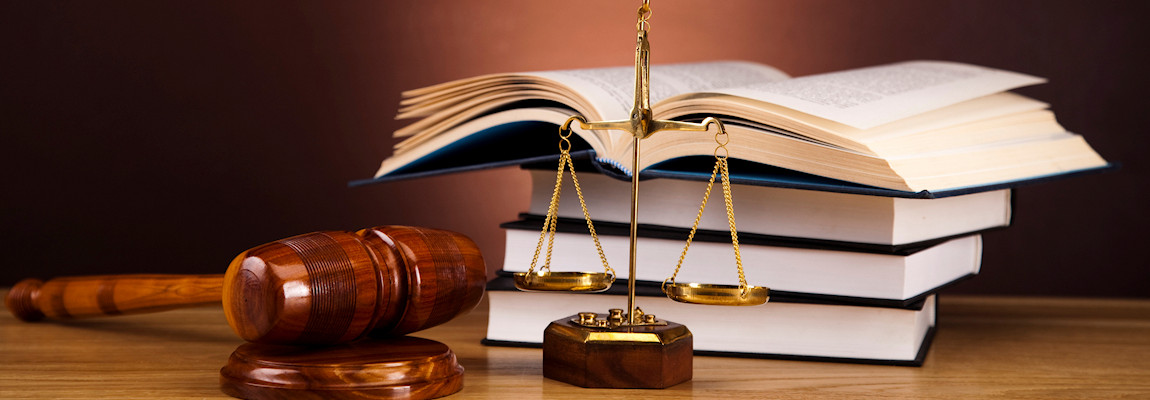 Law Image with gavel, scales and books representing the law firm